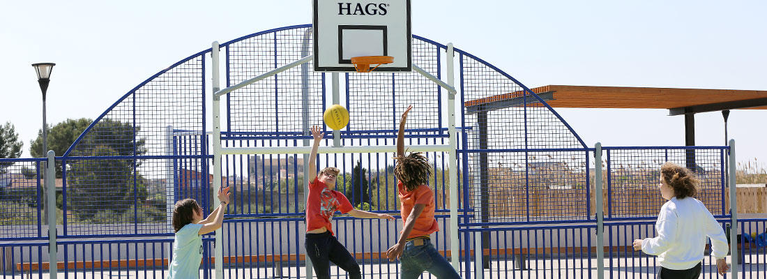 children playing football on a custom multi-sports court