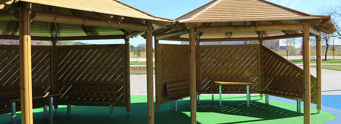 Playground seating shelters in timber