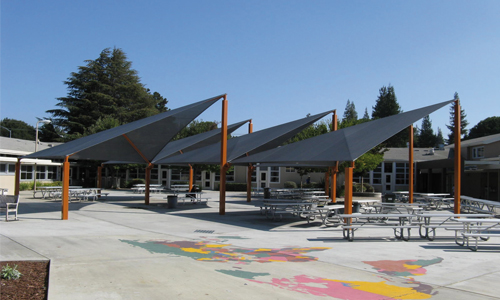 Shade structures for outdoor seating areas